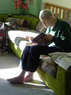 Grandpa looking at a book
