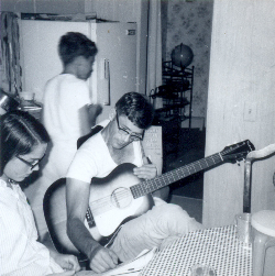 Grandpa in former days, playing his guitar