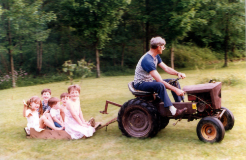 Grandpa giving a tractor ride